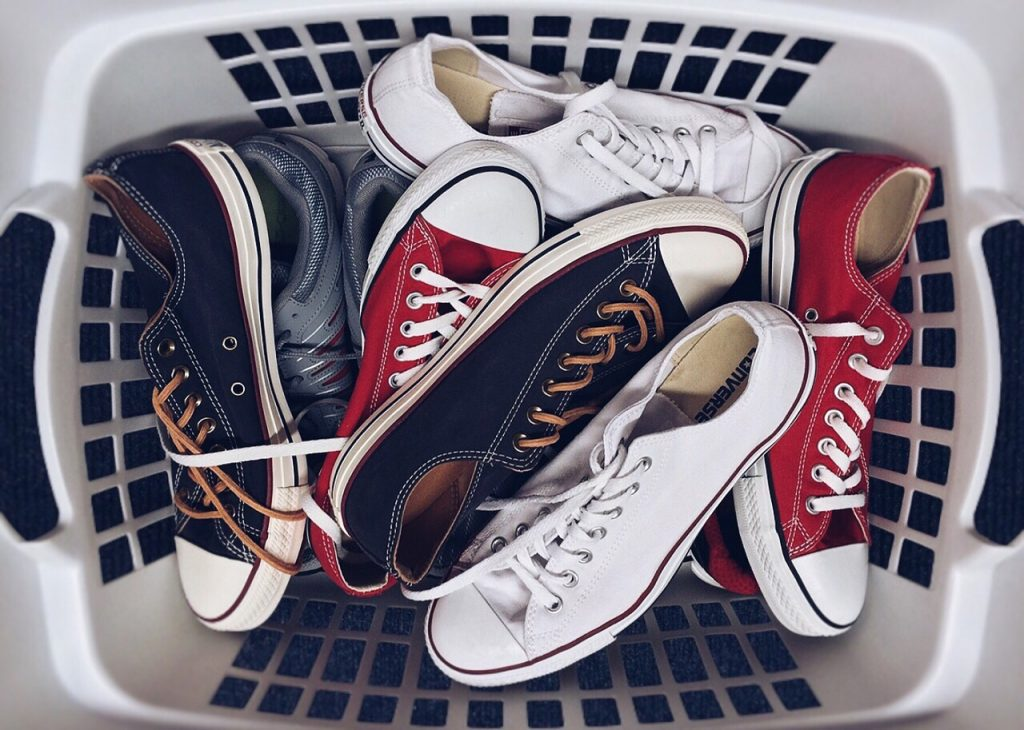 Never throw your footwear into the washing machine!